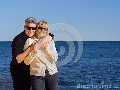 Relaxed healthy couple enjoying the coast