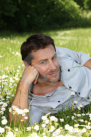 Relaxed man lying in a field
