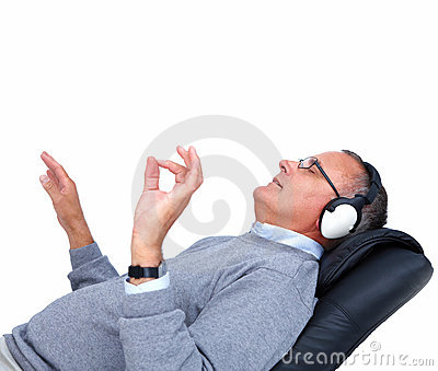 Relaxed mature man listening to music - copyspace