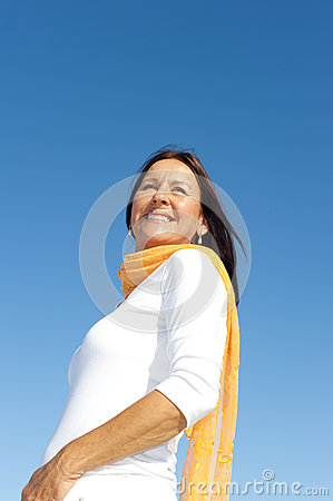 Relaxed mature woman sky background