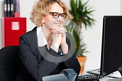 Relaxed portrait of beautiful aged corporate woman