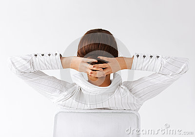 Relaxed woman from the back with arms on head