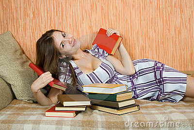 Relaxed woman with books