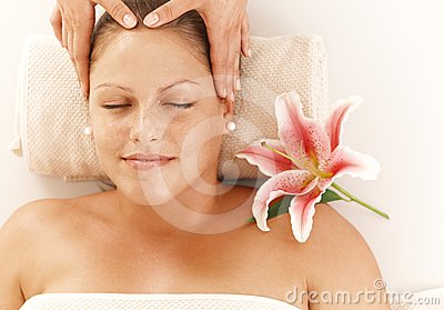 Relaxed woman getting head massage