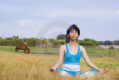 Relaxed woman meditates