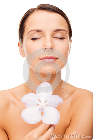 Relaxed woman with orhid flower
