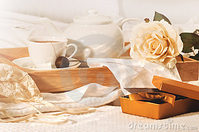 Relaxing in bed with tea and chocolates