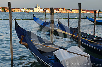 Relaxing evening in gondolas harbor, Venice