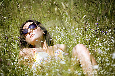Relaxing girl on a meadow.