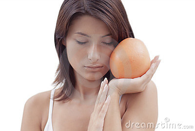 Relaxing girl with an orange fruit