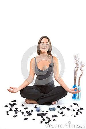 Relaxing girl in yoga position