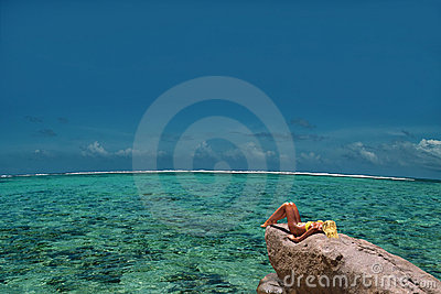 Relaxing model on lagoon rock. Top & endless.