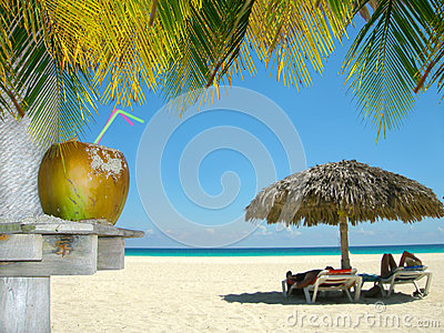 Relaxing people on tropical beach