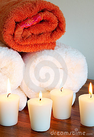 Relaxing spa scene with rolled up towels