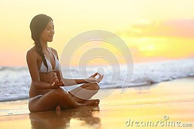 Relaxing - Yoga Woman Meditating At Beach Sunset Stock ...