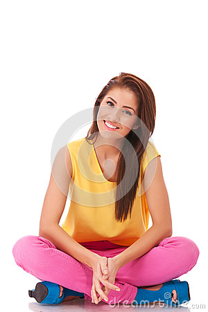 Relaxing young casual woman sitting down
