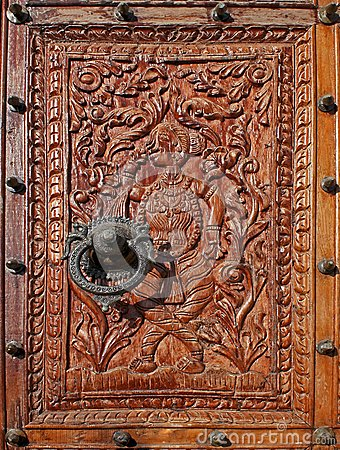 Relief carved wood with a Beautiful metal Knocker