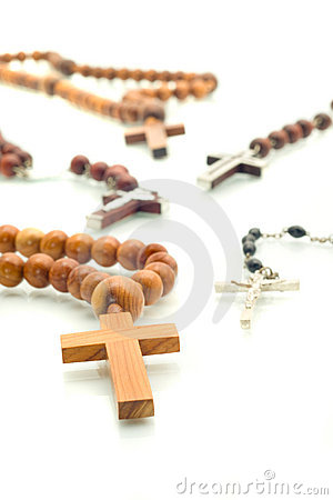 Religion diversity - rosary beads over white