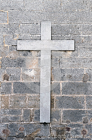 Religious cross on old wall