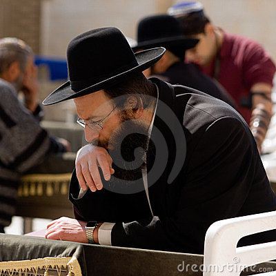 An religious prays near the Wailing Wall Editorial Image