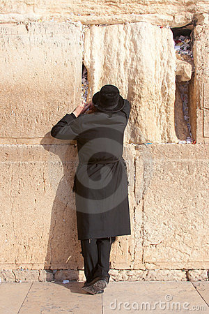A religious orthodox prays at the Wailing Wall Editorial Photography