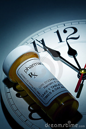Reloj y botella de píldora