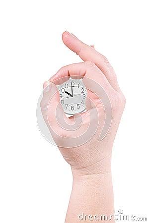 Reloj y palma