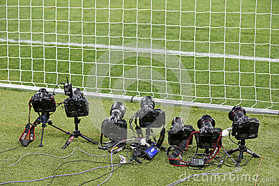 Remote control photocameras stand on the field Editorial Image