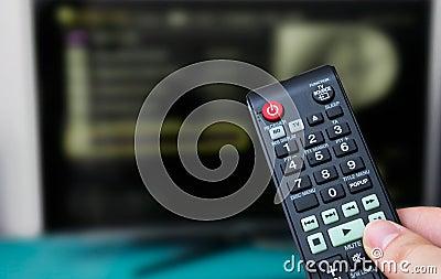 Remote control, TV in background