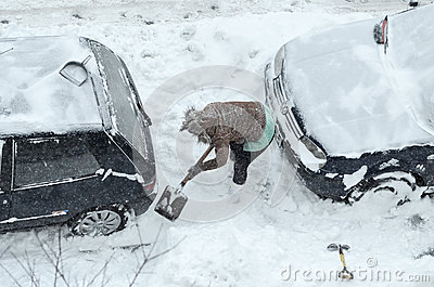 Removing snow from the cars Editorial Photography