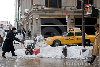 Removing snow after the storm in New York City Editorial Stock Image