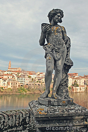 Renaissance statue with Albi town and Tarn River