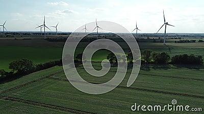 Onshore wind farm green fields, 4k stock video