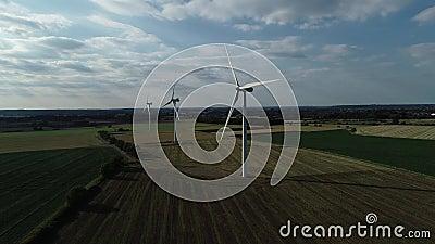 Onshore wind farm green fields, 4k stock video footage