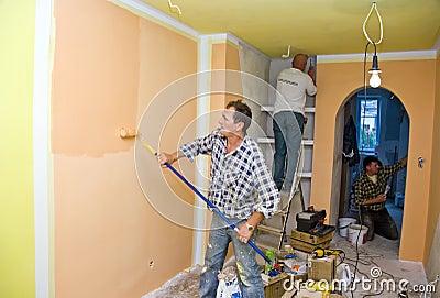 Renovation team painting room