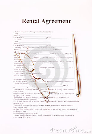 Rental agreement form with pen and glasses