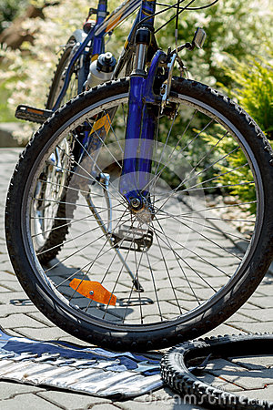 Repair of bicycle, prepare to change old tyre with tools