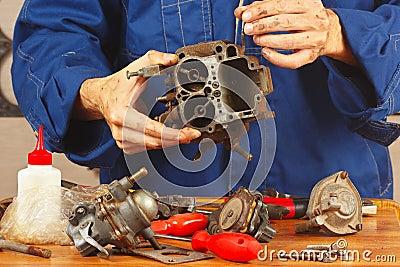 Repair of details old automobile engine in workshop