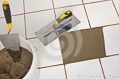 Repaired old white tiles floor with Trowel