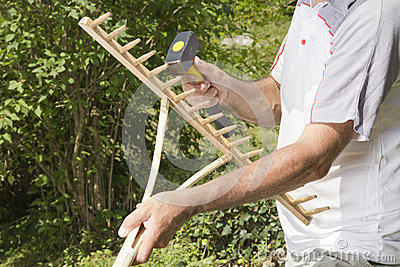 Repairing wooden rake- closeup