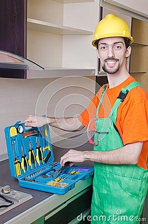Repairman assembling the furniture