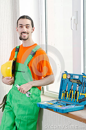 Repairman in coveralls - industrial concept