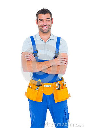 Free Repairman In Overalls Wearing Tool Belt Standing Arms Crossed Royalty Free Stock Photos - 50478468