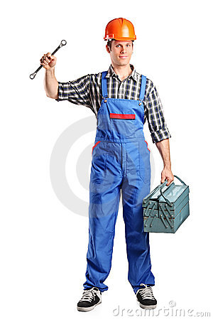 Repairman in overall holding a toolbox and wrench