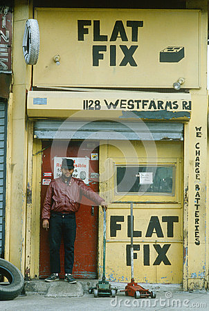 A repairman at a tire shop, Editorial Photo