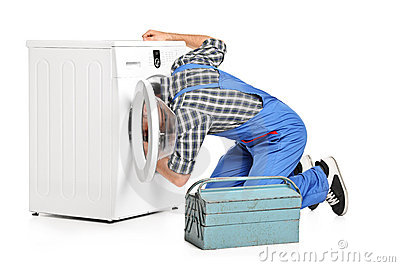 Repairman trying to fix a washing machine