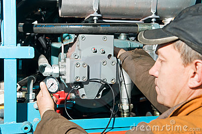 Repairman using manometer