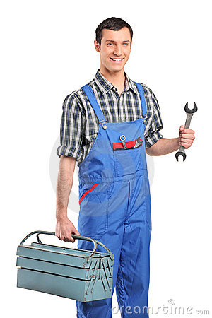 A repairman in verall holding a toolbox