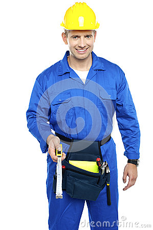 Repairman at work holding measuring tape