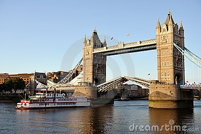 Replica of paddleboat passing through Tower Bridge